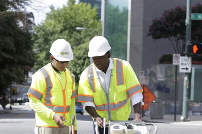 Mayor Stoney learns how to mark a crosswalk for pedestrian safety.