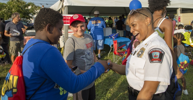 staff visiting kids at National Night Out 2019