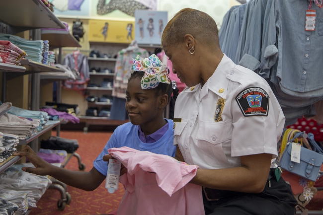 staff help kids shop for school clothes
