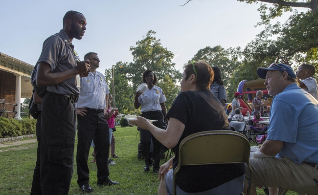DEC staff visit neighbors during National Night Out